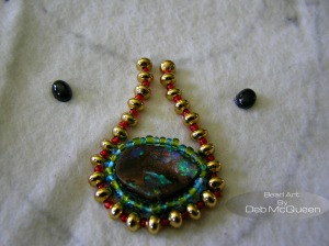 G.P. saucer beads placed on their sides, with red seedbeads between each saucer bead