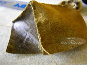 stitching the first salmon skin side to the moose hide