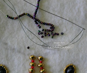 switching to size B nymo and a size 13 needle applying size 13/0 seedbeads